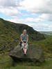 Tanya sits atop a rock
