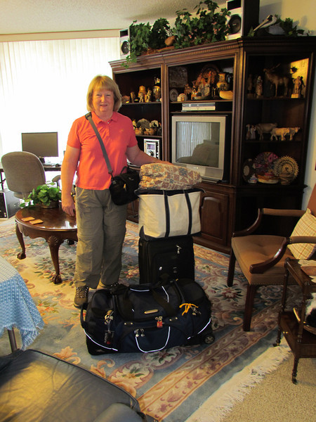 Shirley ready to leave for Nepal, Bhutan, Tibet, China with luggage of duffel bag, rolling carry on , tote and purse.  5/14/2012