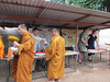 The monks line up to get donated food from the village people.  Tiger Temple, 8/17/2012