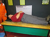 Ken laying on a bed of nails, Oil and Gas Discovery Center.  8/30/2012