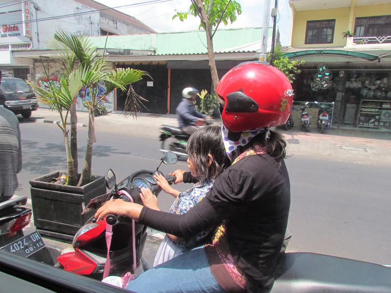 Families riding on scooters, Yogyakarta, Java, 9/6/2012