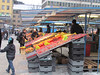 Market selling many fruits and vegetables all out in the freezing open air. They had heat lamps over some of the fruits. Stockholm, Sweden,