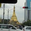 Traffic and temples. Yangon, Myanmar (Burma), 10/18/2013