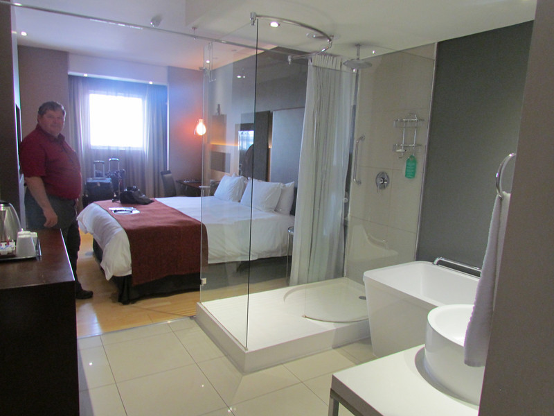 Crazy hotel room with bathroom right inside the door and shower open to the room with curtain that just went on one side!  Protea Hotel OR Tambo Airport, Johannesburg, South Africa. 4/1/2014