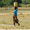 Woman carrying water from the well, near Livingston, Zambia, 4/6/2014