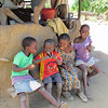 Children next to the kitchen hut for their family, Sindie, near Livingston, Zambia, 4/6/2014