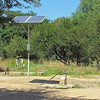 They recently got solar to pump water so they don't have to carry it so far. Sindie, near Livingston, Zambia, 4/6/2014