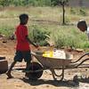 Boys getting water to take home, Sindie, near Livingston, Zambia, 4/6/2014
