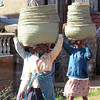 Carrying heavy loads on their heads. Madagascar, 4/12/2014