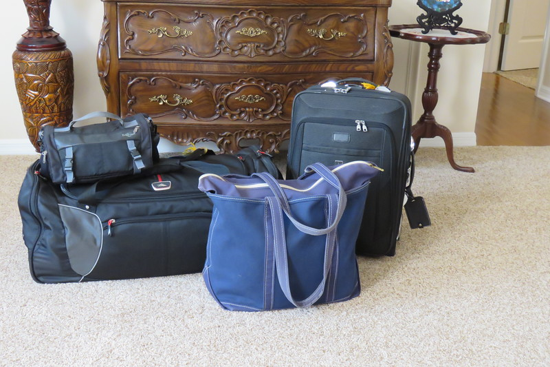 Our duffel bag, tote, rolling carry on and my purse - ready for our trip to South America.  2/9/2018