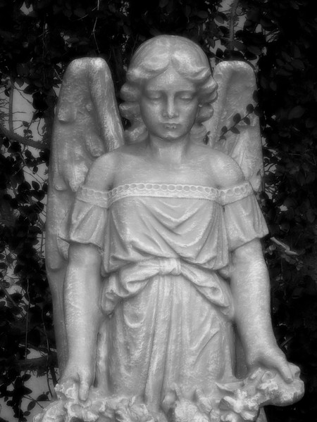 New Orleans, Louisiana 2009 - Angel Statue in the Historic French Market Inn Courtyard