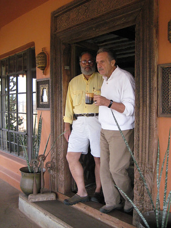 "Wilbur Norman Standing in the Doorway with Alan Donovan (Cup in Hand) at Alan's Home - ""The Most Photographed House in Africa"""