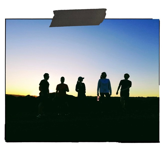 Friends backlit at Sunset