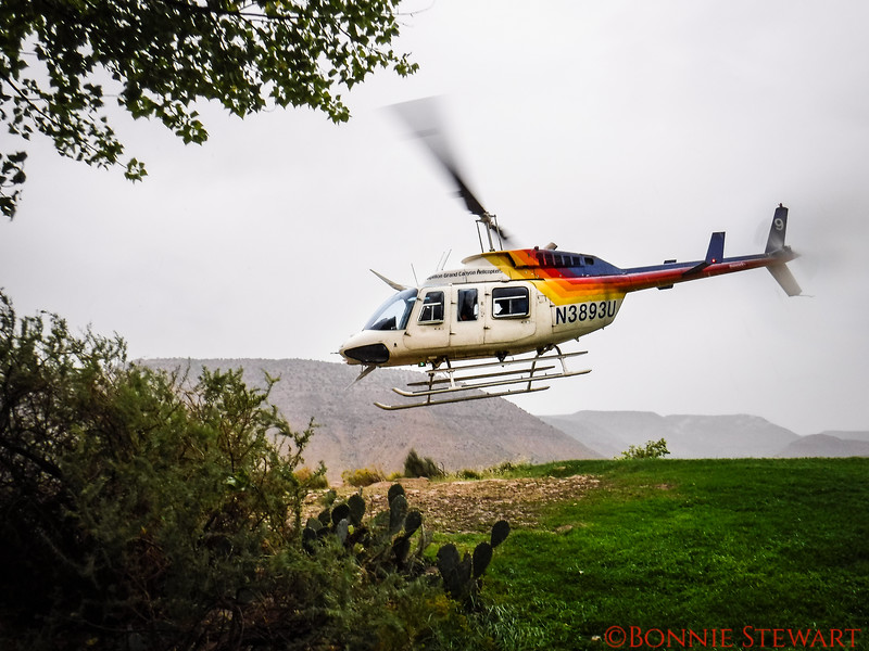 Helicopter taking participants from Bar 10 Ranch to the bottom of the Grand Canyon and the Colorado River
