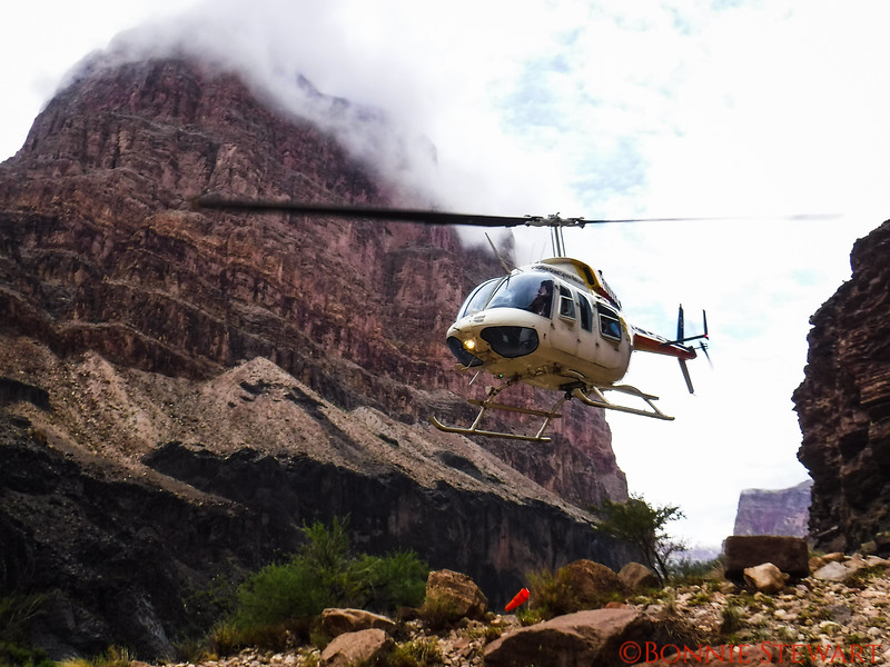 Helicopter taking off from the bottom of the Grand Canyon to get the last group of travelers