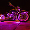 A very flashy motorcycle.   The lights cycle through various colors.