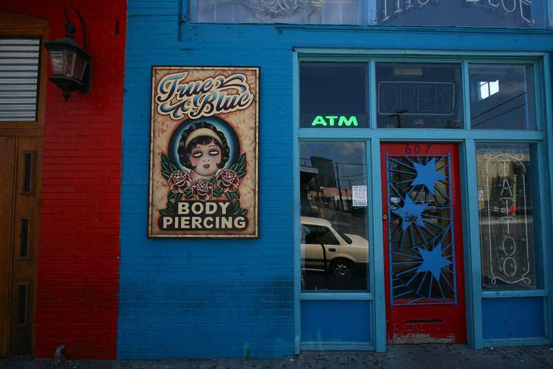 Typical storefront on Red River Street in the heart of the music district