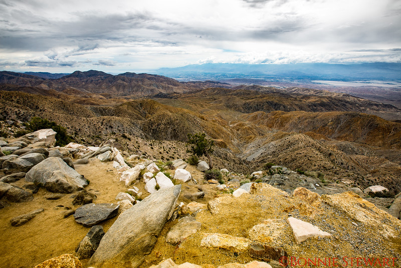Keys View at 5,185 feet with a view of the mountains, valleys, desert.  In the distance is a view of the Salton Sea (upper right)