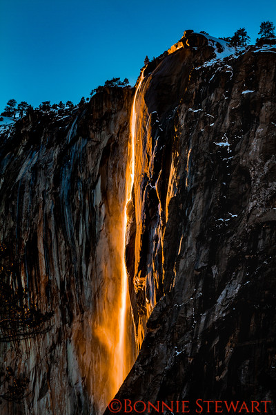 Horsetail Falls in February when the light at sunset creates the illusion of a gold running waterfall.