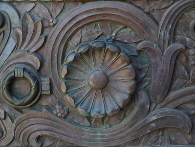 An ornate brass door.