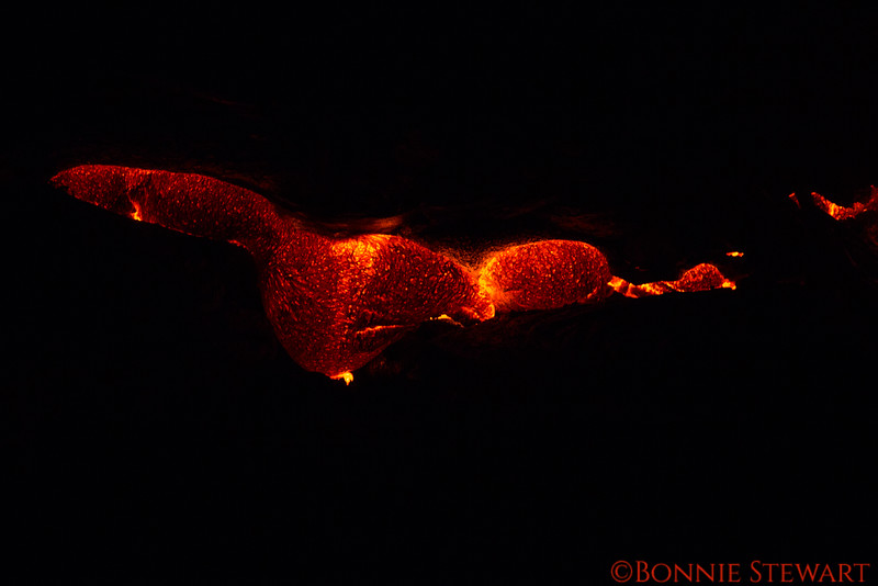 Lava vent swelling up to release molten lava