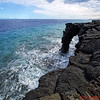 Holei Sea Arch formed by lava flowing into the ocean.  Located at the end of the Chain of Craters Road, it was formed  within the last 100 years.  It will eventually crumble but new lava will form another arch.