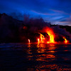 Lava enters the ocean at sunrise at Kamokuna