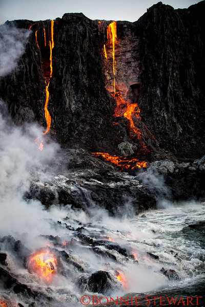 Lava on the cliffs with lava balls in the water