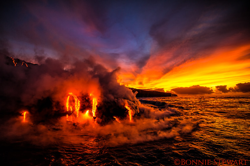 Lava enter the ocean at Kamokuna as sun begins to rise