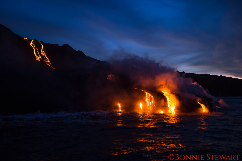 Lava flow from Kilauea Volcano eruption as it reaches the ocean in early morning