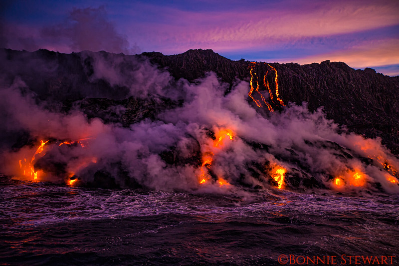 Lava enters the ocean early morning before sunrise