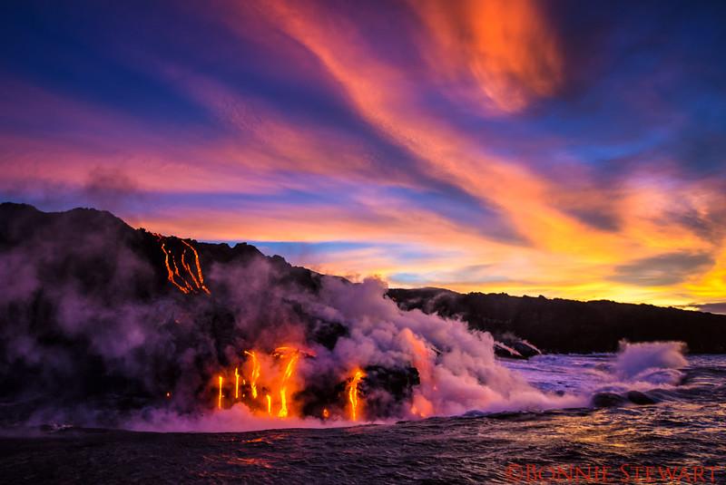 Lava entering the ocean at sunrise