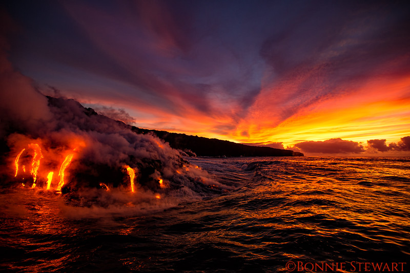 Lava enters the ocean at Kamokuna as sun begins to rise