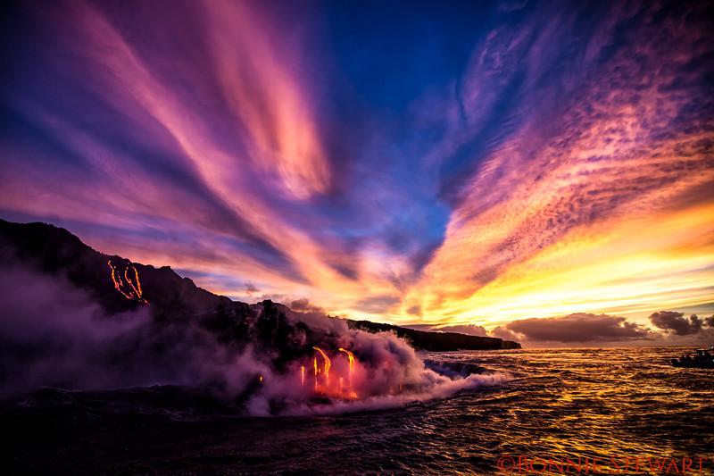 Lava enters the ocean at sunrise at Kamokuna