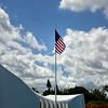 US Flag flies above the USS Arizona Memorial