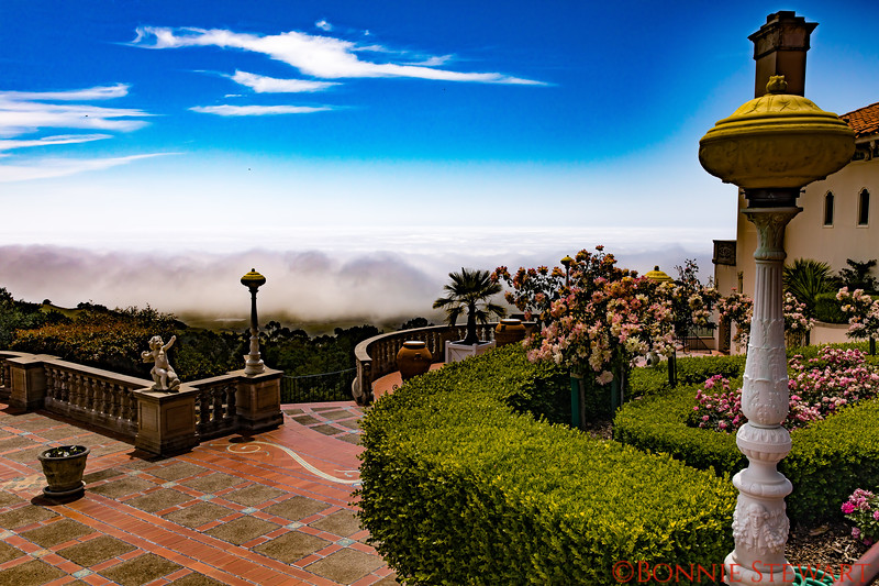 View towards the shore at Hearst Castle.  Fog below covers the shore details.