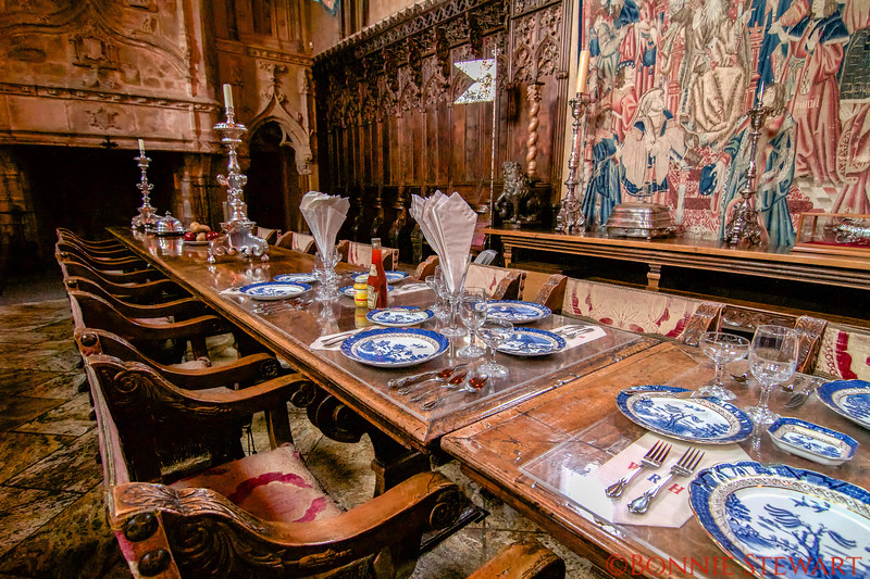 Dining Table at Hearst Castle showing casual condiment bottles on a formally set table.