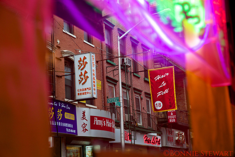 View of China Town street through the window of a restaurant