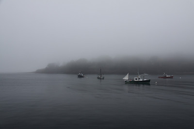 Boats and Island In Fog
