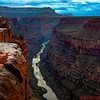 Sunset at Toroweap, between heavy rain and clouds, Top of the Grand Canyon with a  3,000 foot drop to the water.