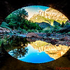 """View under a bridge towards the """"Watchman"""" with river reflections"""