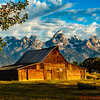 Sunrise at the Thomas Moulton Cabin with the Grand Teton Mountains in the distance