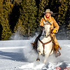 Augustus Bercher riding in the mountain snow