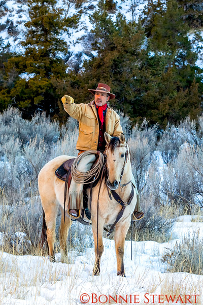 Wrangler Tom on his horse after the run in the snowy canyon