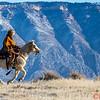 Wrangler Marijn riding her horse