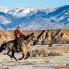 Wrangler Tom riding his horse