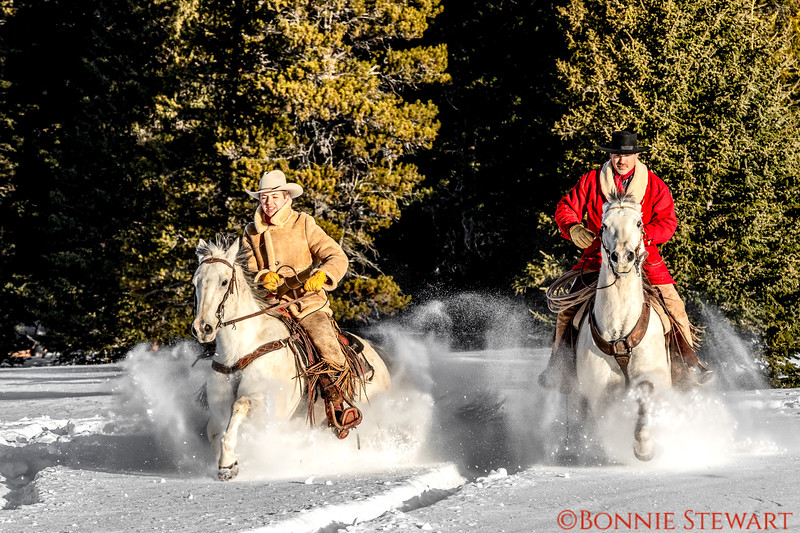 Augustus and Tom Bercher ride together in the mountain snow