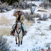 Wrangler Tom running through the snowy canyon