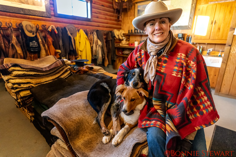 """Marijn and her dogs in the """"well organized"""" tack room"""