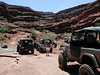 "After a few challenges going south on Lockhart Basin trail, Keith's YJ was loosing too much rear diff fluid and transfer case fluid to continue.  We returned to Moab using up the ""spare"" diff fluid.  Next day, visit to Moab 4X4 Outpost, the YJ was cured.  (Keith will have to reveal the fix.)"